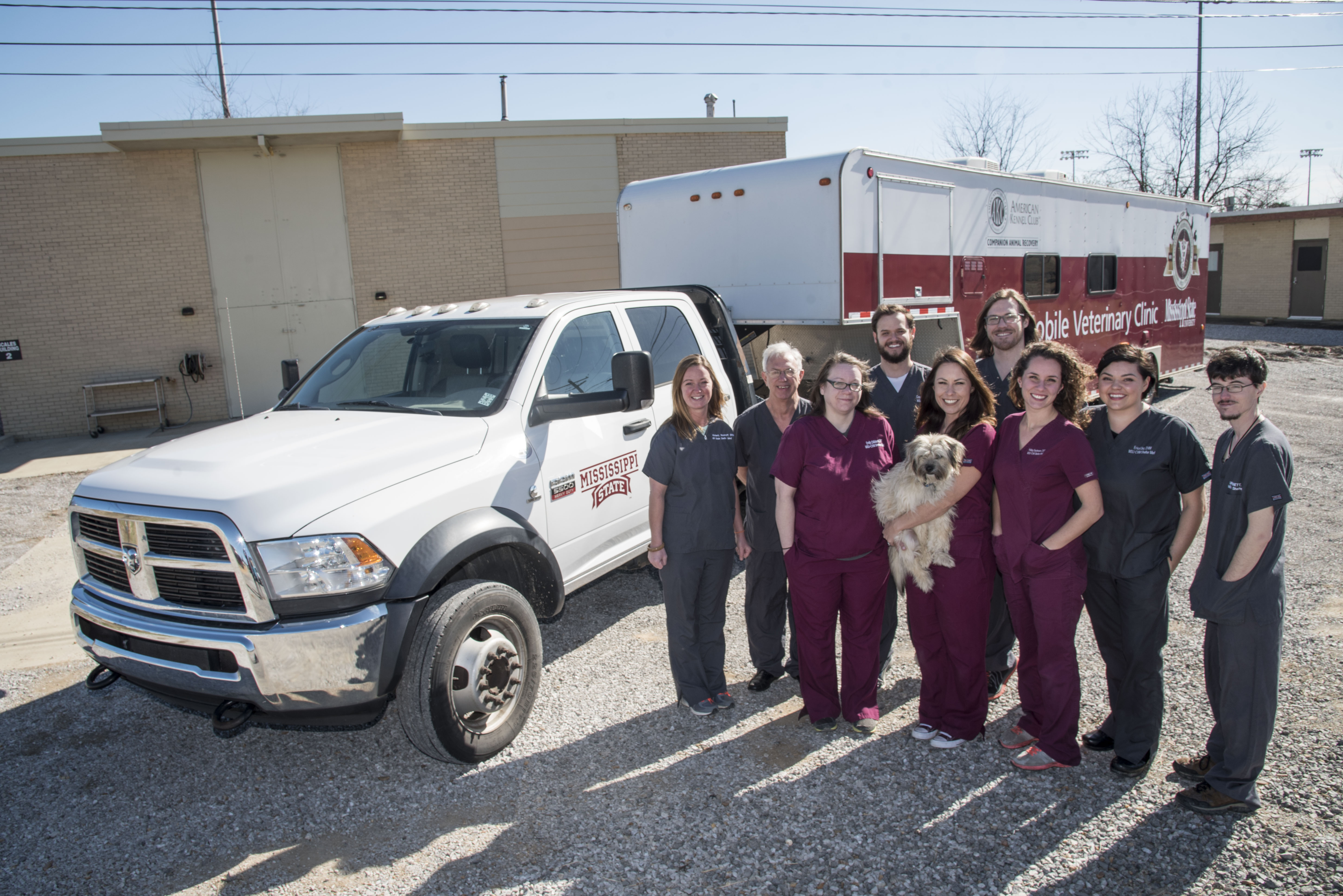 A team poses outside of the shelter medicine mobile unit